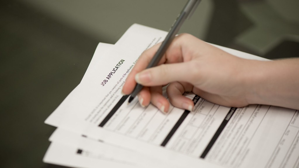 A job application form being completed